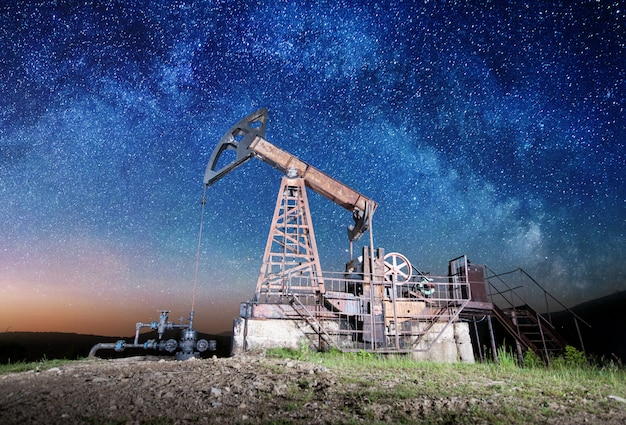 Oil pump on the oil field in the night