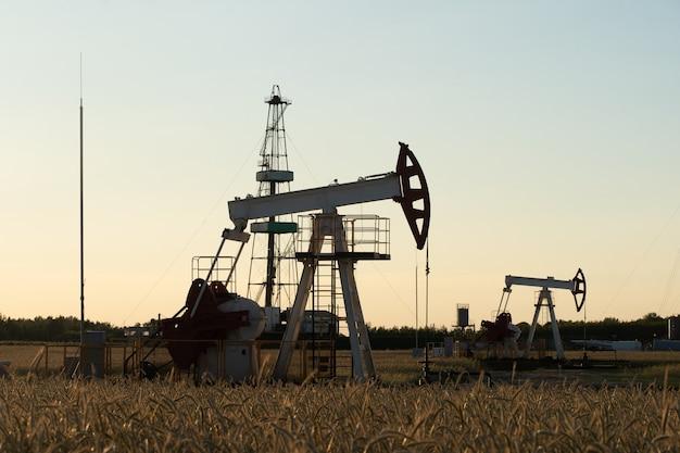 Oil pump on orange sunset.