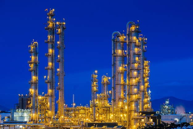 Oil refinery industrial plant with twilight sky background