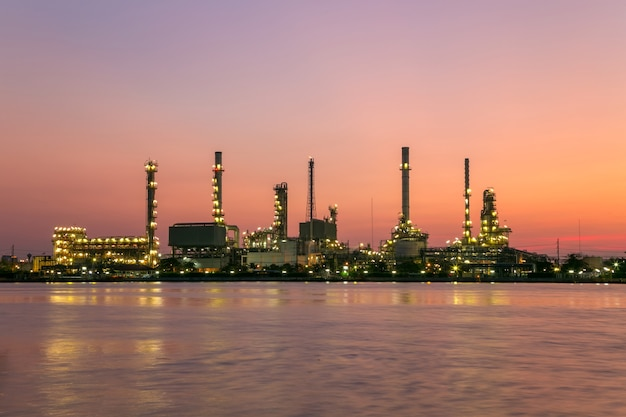 Oil refinery plant from industry, petrochemical oil and gas refinery and pipeline industry with sunrise sky.
