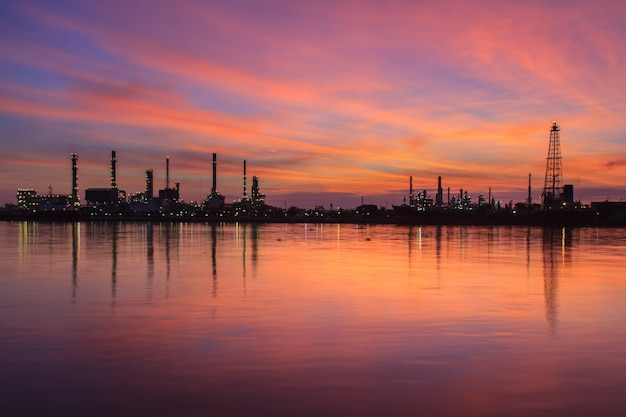 Oil refinery silhouette along the river at sunrise time (bangkok, thailand)