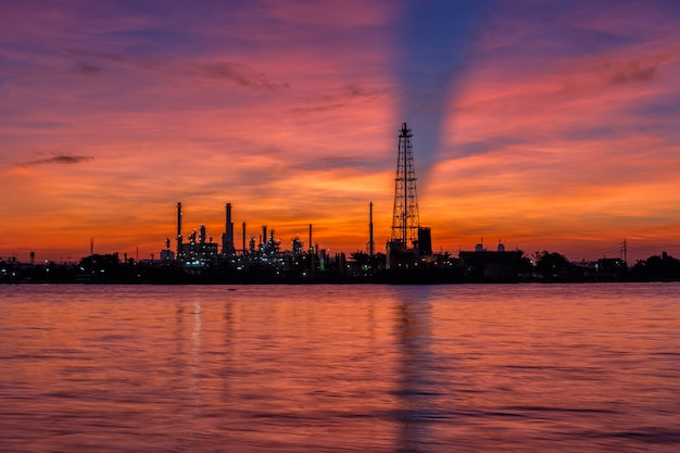 Oil refinery and surrounding communities at twilight