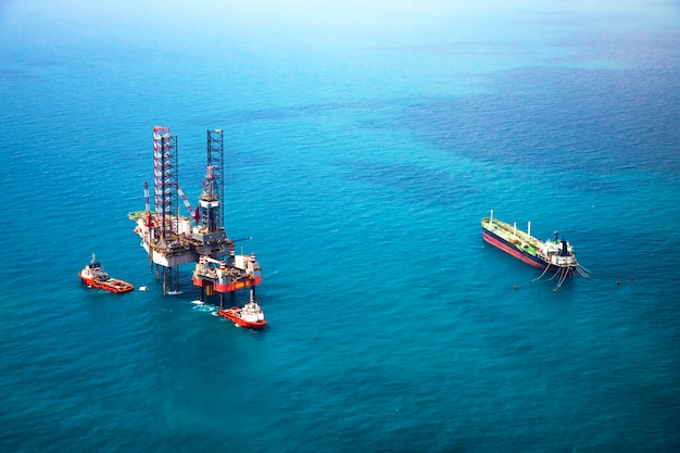 Oil rig in the gulf with oil tanker ship