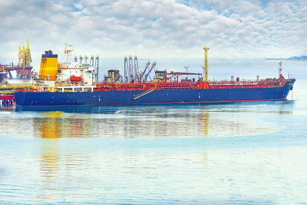 An oil tanker in the novorossiysk port is loaded with crude oil