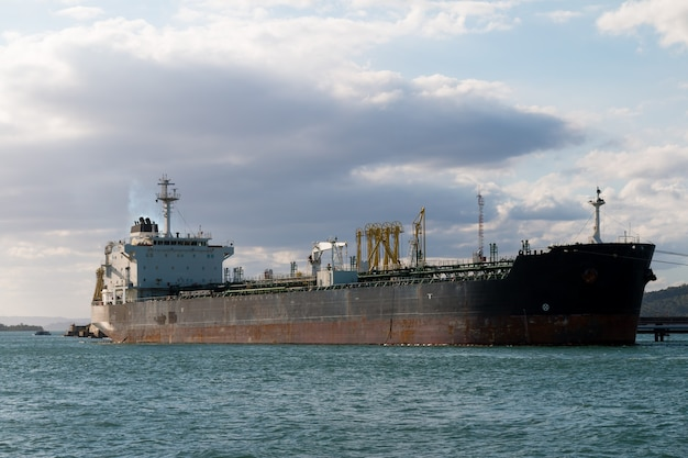 Oil tanker ship anchored in port.