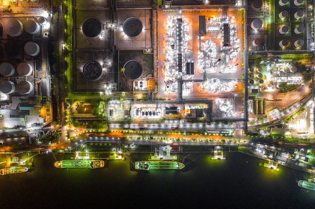 Oil tanker ship loading in port at oil refinery, aerial view from above.