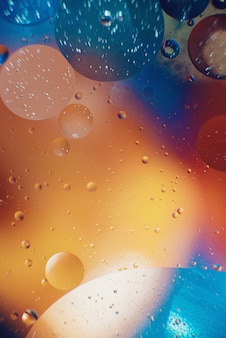 Oil with bubbles on a colorful background. abstract background. soft selective focus