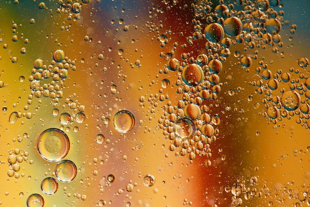 Oil with bubbles on on dark blue background. abstract background.