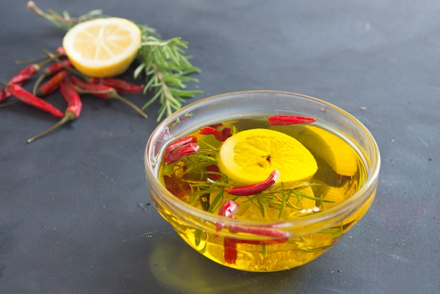 Oil with lemon, garlic, rosemary and chilly