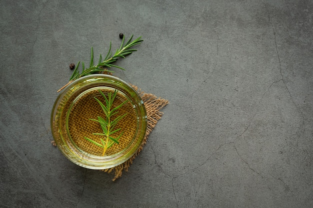 Oil with rosemary on table