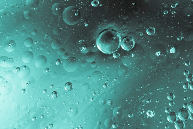 Oily bubbles in water with drops