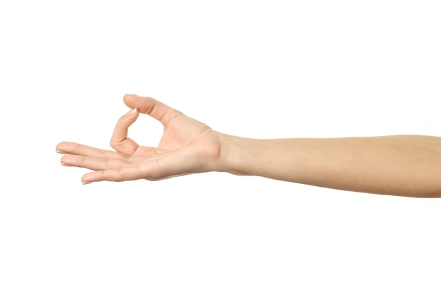 Ok sign. woman hand gesturing isolated on white