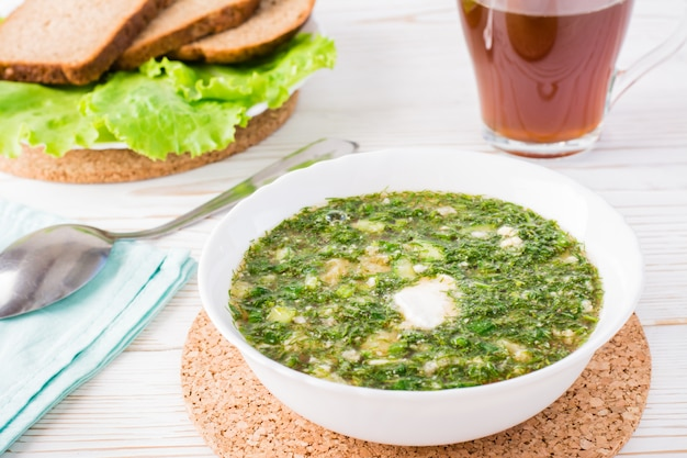 Okroshka is a traditional russian dish. cold soup with vegetables and herbs dressed with bread kvass