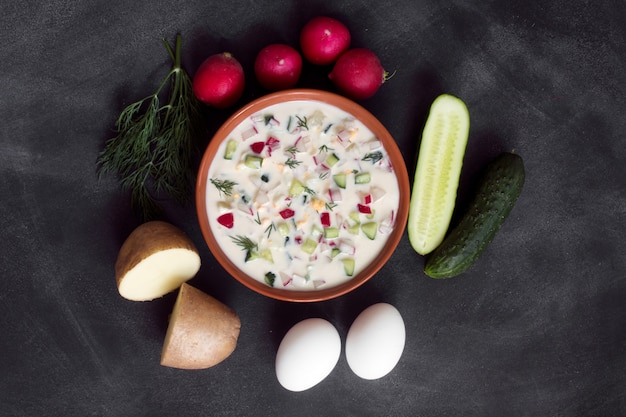 Okroshka. traditional russian summer yoghurt cold soup with vegetables