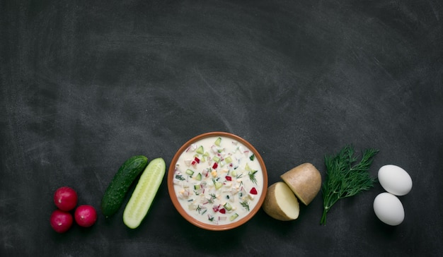 Okroshka. traditional russian summer yoghurt cold soup with vegetables.