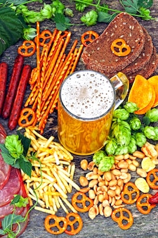 Oktober fest. glass of beer and beer snacks.