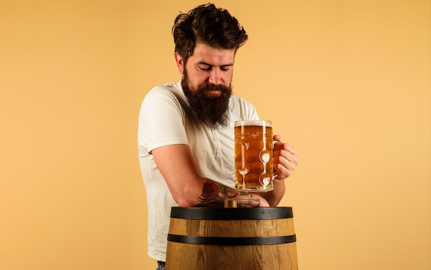 Oktoberfest. bearded man drinking craft beer. guy with glass delicious ale. pub and bar. brewer. alcohol