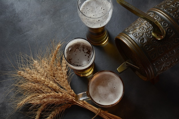 Oktoberfest beer barrel and beer glasses with wheat
