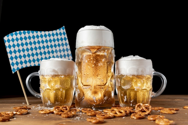 Oktoberfest beer mugs with snacks on a table