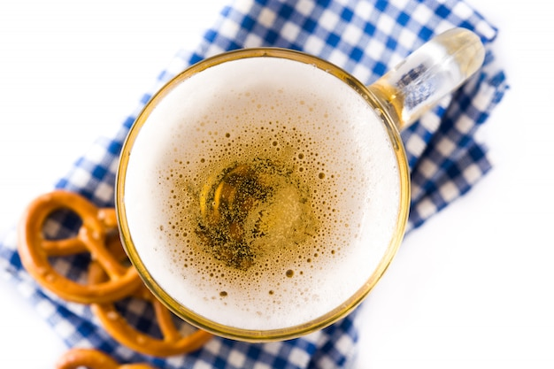 Oktoberfest beer and pretzel isolated on white background. top view