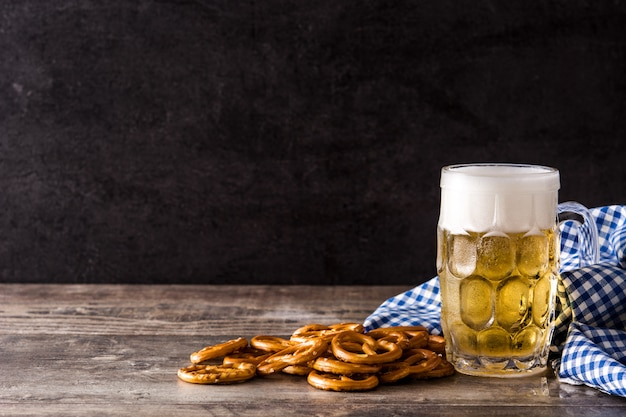 Oktoberfest beer and pretzel on wooden table copy space