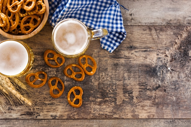 Oktoberfest beer and pretzel on wooden table