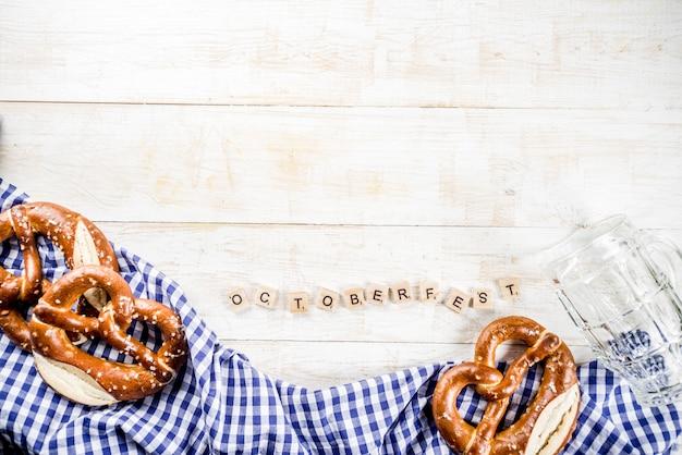 Oktoberfest food menu, bavarian pretzels with beer bottle mug