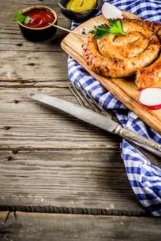Oktoberfest food menu, bavarian sausages on wooden table,