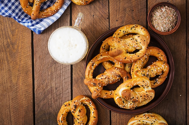 Oktoberfest salted soft pretzels in a bowl and beer from germany  top view