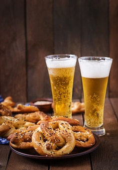 Oktoberfest salted soft pretzels in a bowl and beer from germany