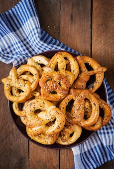 Oktoberfest salted soft pretzels in a plate from germany on wooden background. top view