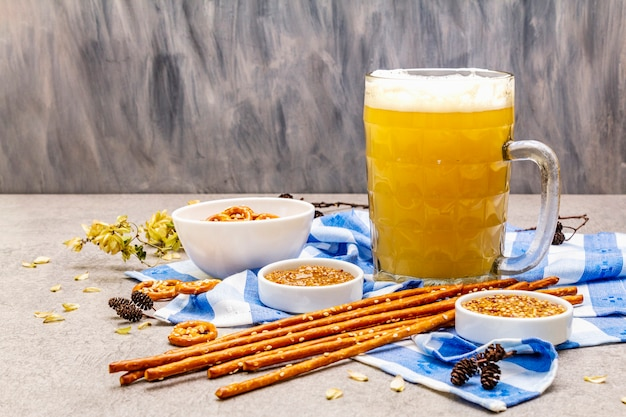 Oktoberfest set. light beer, pretzels, mustard, sesame straw, hop.