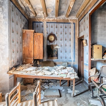 Old abandoned office with many documents