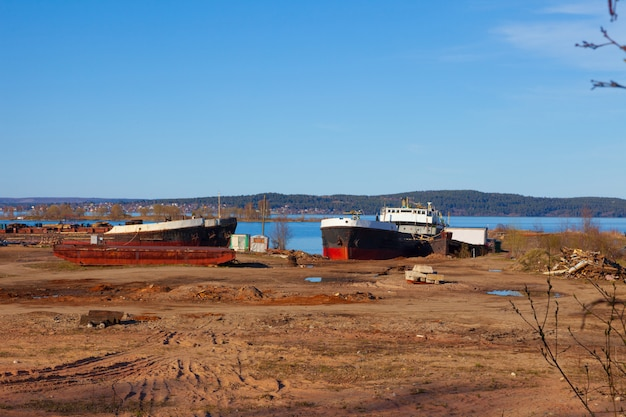 Old, abandoned ships in the port