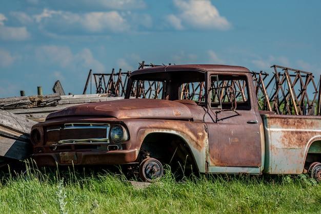 Old abandoned truck in junk yard on the prairies in saskatchewan