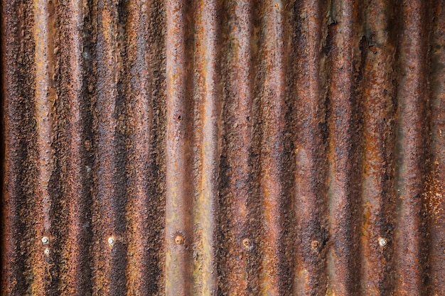 Old aged vintage rusty corrugated zinc metal sheet