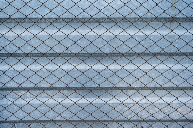 Old aluminum galvanized background covered with wire mesh grille. metal texture