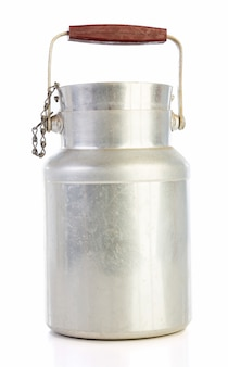 Old aluminum milk jug isolated