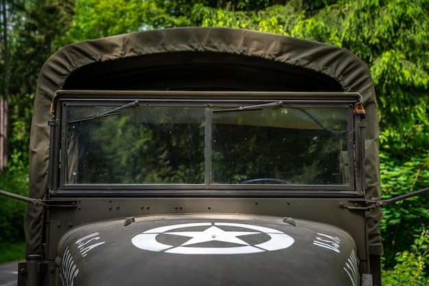 Old american army car in the woods