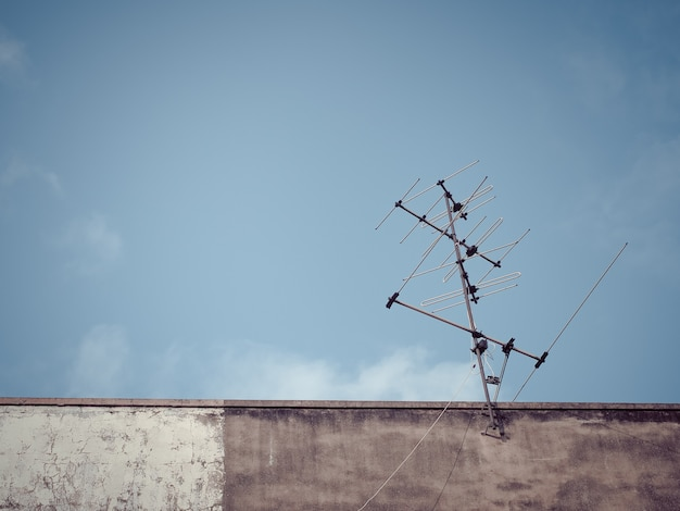Old analog antenna for tv with blue sky