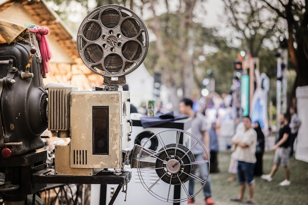 The old analog rotary film movie projector at outdoor cinema movies theater