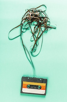 Old audio cassettes on turquoise