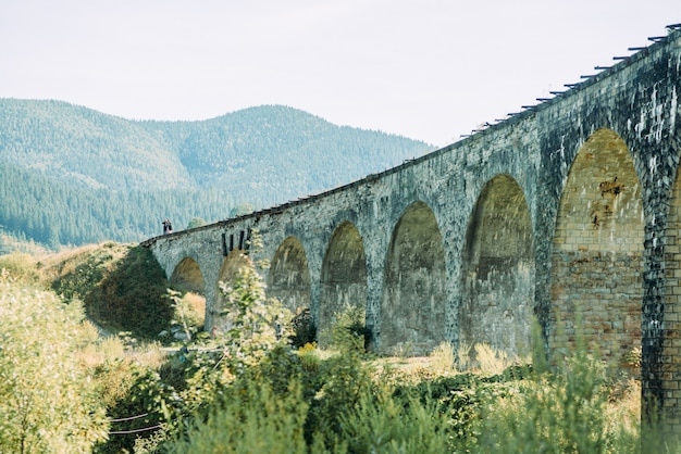 Old austrian stone railway bridge viaduct in vorohta ukraine