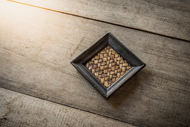 Old bamboo coaster on wooden