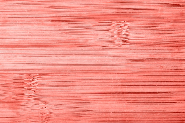 Old bamboo wooden texture background. living coral toned image.