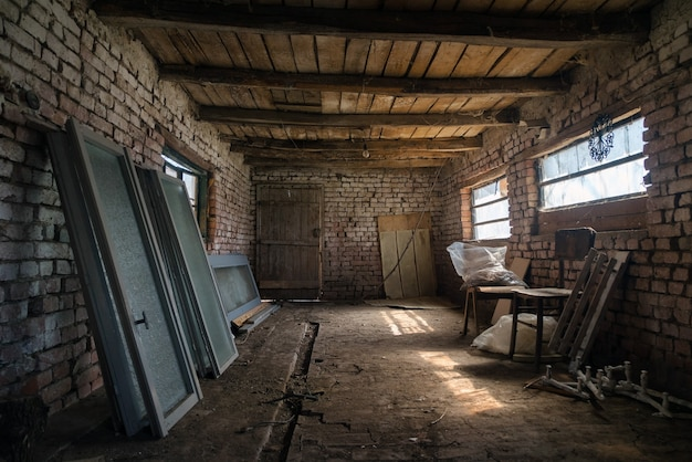 Old barn interior in the village, vintage shed built of wood and brick.