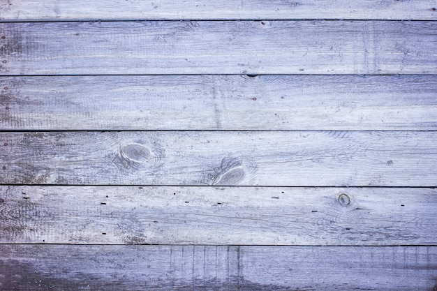 Old barn wood blue grey plank door draped texture background