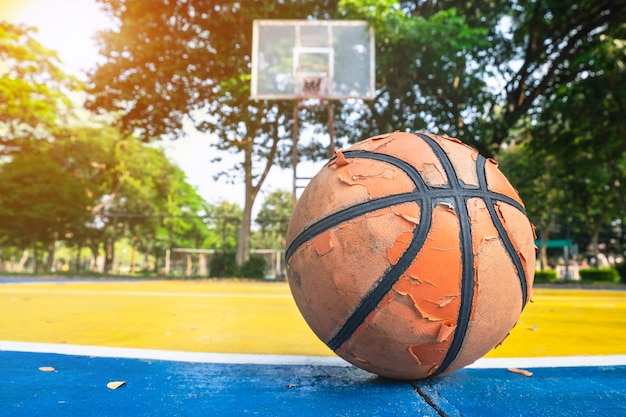 Old basketball in the basketball court.