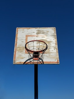 Old basketball hoop in a basketball arena.