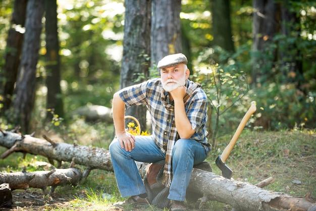 Old bearded man in forest fashion portrait man aged funny forester woodman in forest old bearded man...